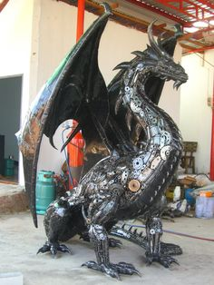 You don't HAVE to have a 2 metre high dragon.  They do sculptures as small as 10cm high - or you can commission your own.  More pics on Facebook.
