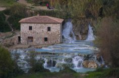 Relax in Cascate del Mulino's Waterfall Terraces in Saturnia, Italy