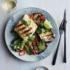 Get star chef Tom Colicchio's Grilled Sea Bass with Marinated Eggplant recipe from Food & Wine.