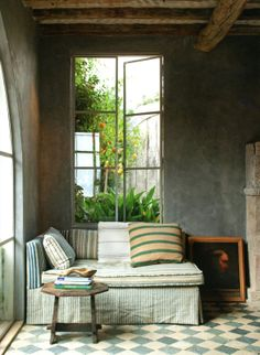 Elegant corner sitting area. Image from the book Rooms to Inspire by the Sea written by Annie Kelly. Photograph by Tim Street-Porter. Via www.painting-box.com.
