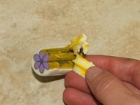 Polymer clay art by naama zamir - using playdough to reduce flower canes so you don't need a background. (OBG 2009) #Polymer #Clay #Tutorials