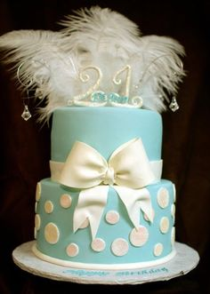 That tiny blue box all girls know and love tied with a pretty white bow... that was the inspiration for this 21st birthday cake.
