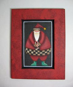 Folk Art, Santa Claus with a Candy Cane, Tole Painted, and Framed in Shades of Red. $20.00, via Etsy.