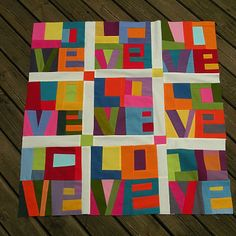 LOVE quilt by quiltycat: I'll make each block a color block. Ex: yellow print with yellow texture... and do a series of pillow in diffrent colors!