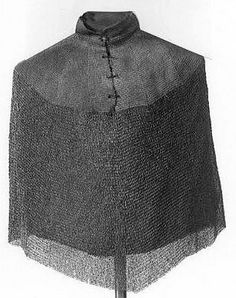 European (Italy) riveted mail Bishops mantle, 16th century, Iron & brass, straight collar with a ring of brass links. Collar and shoulder part of dense mail. Front slit to the chest and held together by a cord. Without sleeves, sides straight sloping, front taper to a point, 69 in long. Weight: 5100 g. Deutsches Historisches Museum (Berlin).