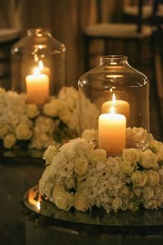 Candles With Hurricanes and White Floral Wreaths