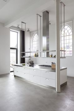 I could have this hanging shelf above the kitchen bar for glasses if the back wall is all window!