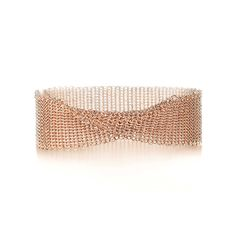"""Elsa Peretti®:Mesh Narrow Bracelet ELSA PERETTI® MESH NARROW BRACELET The form is malleable and ergonomic in the way it drapes over the body's contours. Narrow bracelet in 18k rose gold. Medium, fits wrists up to 6.25"""". Original designs copyrighted by Elsa Peretti."""