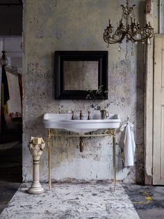 Aged brass taps add heritage character to the smooth porcelain of the Empress console by Catchpole and Rye