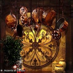 Beautiful Tuscan decor.....not the pots n pans hanging, but the metal and stone