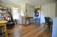 The functional and homey craft room, wood floor, a sink for cleaning, closets for storage. SouleMama.