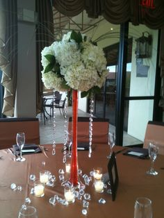 Eiffel Tower Vase with tangerine colored water, hydrangea, salal and crystal accents.  Design by Lana with Fairbanks Florist.