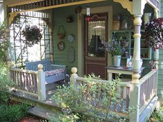 what a cozy front porch! I would love to have a glider like my grandparents had.
