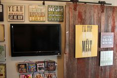 Tons of vintage decor ideas on this site, but this is my fav.  A barn door hung on wall slides to cover the TV.  LOVE it!