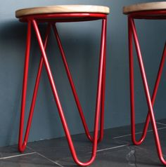 This is a great hairpin legged stool in wood and red metal.Other colours available on request.This wood and metal stool has a great pared-back feel. It has three hairpin legs in red coated metal and a wooden seat. They are a great height to add a flash of colour at your kitchen table. Great as a set or just individually for that mixed up, ecclectic feel.Material: metal and woodHeight : 49 cm Diameter : 30 cm View in Inches Weight : 1,200 g