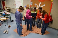 Can your team stand on a blanket and flip it - without anyone getting off? Team Manager Cafe 2012 Training - NH Destination ImagiNation Photos - New Hampshire's Incredible Creativity Connection NHICC Team Building Exercises, Team Games, Team Building Activities, Group Games, Team Activities, Leadership Activities, Destination Imagination, Team Bonding, Youth Games