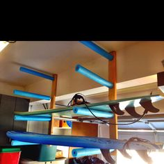 2x4 + Wood Dowels + Pool Noodles = Surfboard Rack YES! also using foam noodles to make a surf rack for the top of the car will run you around $5....buying virtually the same thing from the surf shop= $45! more money for after surf smoothies....