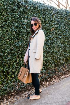 Amy Havins wears a blush sweater paired with skinny jeans and ballet flats.