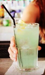Tokyo Iced Tea Cocktail Recipe: - 1/2 oz Vodka - 1/2 oz Light Rum - 1/2 oz Gin - 1/2 oz Tequila - 1/2 oz Midori/ De Kuyper Meloт Liqueur - 3/4 oz Fresh Lemon Juice - 1/2 oz Sugar Syrup - Top with Sprite/ Lemonade Glass: Highball Ice: Cubed Method: Shake and strain Garnish: Lemon wedge