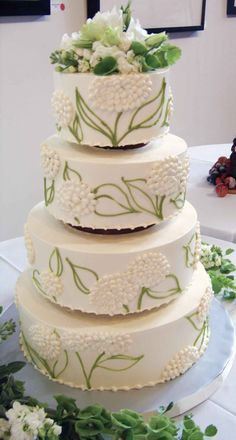 Wedding Cakes: Leaf and flower detailed wedding cake with flowers