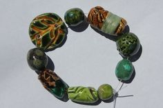 Handmade Ceramic Beads and Disc Set of 8 by BlackHairySpiderArts