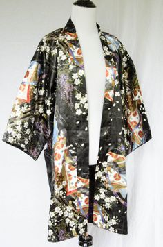 This lovely black kimono is printed with vibrant flowers and scenes. Perfect for swanning around the house!  Size S / M