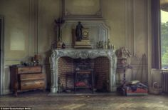 ❥ Inside the abandoned Belgium mansion brimming with expensive furniture and half full glasses as if the owners just upped and left~ Fabulous fireplace and dresser… I would clean this place up and live in it if I could.