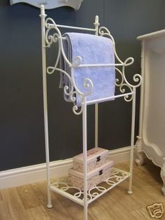An ornate towel stand finished in ivory  This freestanding towel stand is a perfect finishing touch to any French inspired bathroom  It has beautiful scroll effect detailing and provides ample towel storage  The towel rail has 4 hanging rails and base plate for further towel or toiletry storage  The towel rail measures 111cm high x 43cm wide x 33cm deep