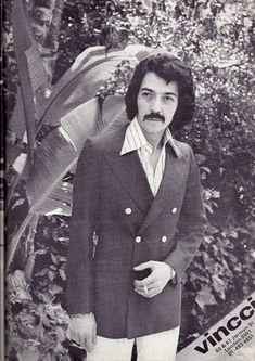 men had long hair and a lot of facial hair in the 1970s.