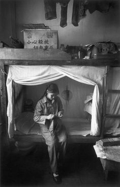 Marc Riboud Yunnan province. City of Kunming. A student from Shanghai, in the dormitory of the factory where she uses to work.  1965.