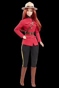 Canadian Mountie Barbie a bit disturbing but fun decoration.  I think a revised game of Elf on the Shelf would be fun using her.