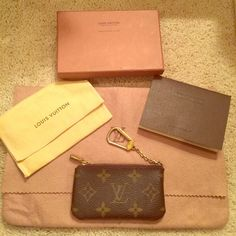Authentic Louis Vuitton Cles key pouch Authentic LV Cles key pouch. Good used condition. Comes with box, dust bag and booklet. Some wear and fading on gold hardware. Date code is nearly impossible to read but tried to capture it in the last picture. Very slight perfume smell. I bought this from another posher and I just don't use it like I thought I would. I bought a Tulum pochette that's a little bigger so I don't need this anymore. Louis Vuitton Accessories Key & Card Holders