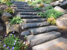 Paver Steps - Cambridge Cast Stone Steps- Bluestone Blend set into staggered New York State Boulder retaining wall. http://greenislanddesign.com/
