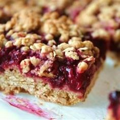 "Delicious Raspberry Oatmeal Cookie Bars - Very convenient, quick dessert :) ,, I've made fruit and oat bars before but these are really, really great. Followed the recipe, no effort, room pleaser!! This is my new ""go to"" summer dessert"