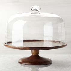 Crate & Barrel Wood Pedestal Server with Dome ($70) ❤ liked on Polyvore featuring home, kitchen & dining, serveware, wooden cake stand, wood cake stands, wooden serveware, wood serveware and wooden cake pedestal