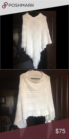 Crochet/knitted shawl/poncho. Can be worn 2 ways. Gorgeous new white crochet or knitted shawl purchased at a high end boutique in September 2016.  I have worn it one time for an afternoon. It can be worn two ways. See pictures. It has one snag as shown in pic 3 but it's on the inside around collar and I'm assuming it happened on the hanger. It is 100 percent acrylic yarn. Sweaters Shrugs & Ponchos