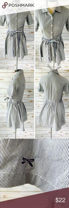 Tommy Girl Dress Tommy Girl Dress  Size Medium.  Denim/White Stripe  Button Front  Belted  Bust Pocket Fold over sleeve  Collard Bow detail on trim  100% Cotton  EUC Tommy Girl  Dresses Mini