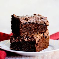 Two glorious pieces of chocolate cake with chocolate frosting!