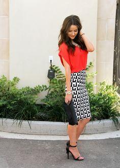 Black & white print skirt styled with orange