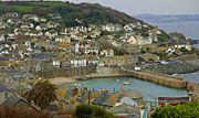 Mousehole is a picturesque fishing village on the south coast of Cornwall between Penzance and Land's End.