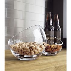 Handmade glass sphere is cut at an angle and polished for a modern look and easy access to snacks, candy, candles or floating blossoms.
