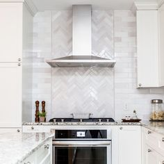 A herringbone pattern behind the range hood always makes a wonderful focal point, especially in the Lesley Farmer kitchen. 📸 by the charming 😘 3 2 Subway Tile & Pencil Liners - 130 White. via @ backsplash ideas Stove Backsplash, White Tile Backsplash, Herringbone Backsplash, Kitchen Backsplash Ideas With Quartz, White Tile Kitchen, Kitchen Backsplash Inspiration, White Subway Tiles, Kitchen Tiles, New Kitchen