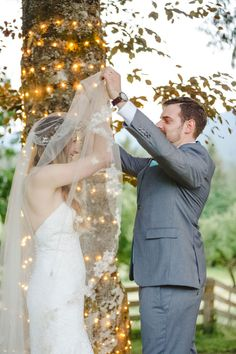 Bride Alleigra in David's Bridal veil with floral lace trim