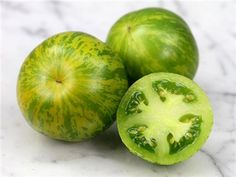 Green Zebra variety. Still green when ripe, but there is yellow striping when ready to pick.