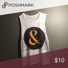 Of Mice and Men tank OM&M tank, bought from hot topic and worn only a few times. Inside tag is worn out. Very soft material, could fit small or medium (and possibly large) easily. Hot Topic Tops Muscle Tees