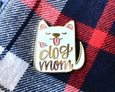 Dog Mom enamel pin - white DETAILS: • Measures aprox. 1.25 at its widest point • Gold metal finish • Metal butterfly clasp • Hennel Paper Co. logo on the back • Ships USPS First-class mail with tracking - - - - - - - - - - - - - - - - - - - - - - - - - - - - - - - - - - - - - - - - - - Follow along with us on Instagram: @hennelpaperco Please visit our shop policies page before placing your order: www.etsy.com/shop/hennelpaperco/policy Return to our shop - www.etsy.com/shop/hennelpaperco