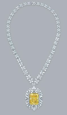 An impressive coloured diamond and diamond pendant necklace
