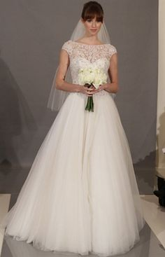 i actually like this... and i am not a poofy dress gal... but this is beautiful... i'm all about the lace :)
