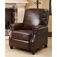 Freshen up your home decor with the Carla brown bonded leather push back recliner. Designed by Abbyson Living, this engaging furniture will brighten any space.