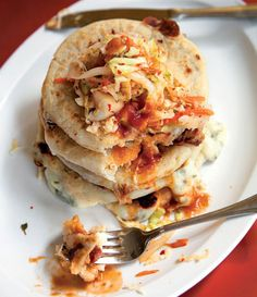 Pupusas are the national dish of El Salvador. Stuffed with cheese and served with a quick slaw, these corn-masa cakes make a satisfying dinner.